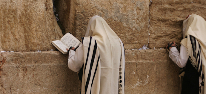 Man-praying-at-the-Western-wall-in-a-traditional-Tallit-or-Prayer-Shawl-_-by-Beggs_crop